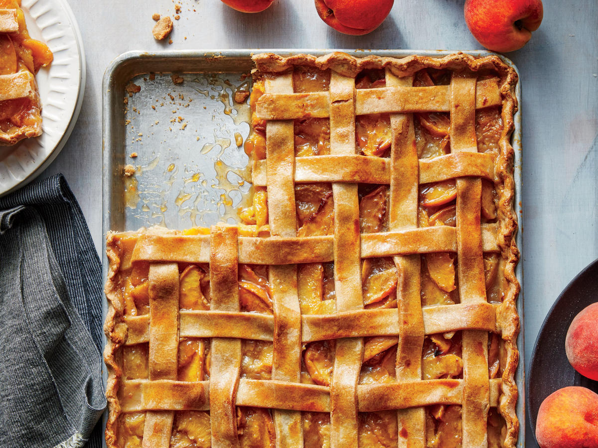 The next time you need a dessert for a crowd—backyard barbecue, picnic, block party—think slab pie. You'll need to roll the dough out so that it's very thin; to make this easier, you can roll it out on parchment paper and place the whole thing, including the paper, in the pan.