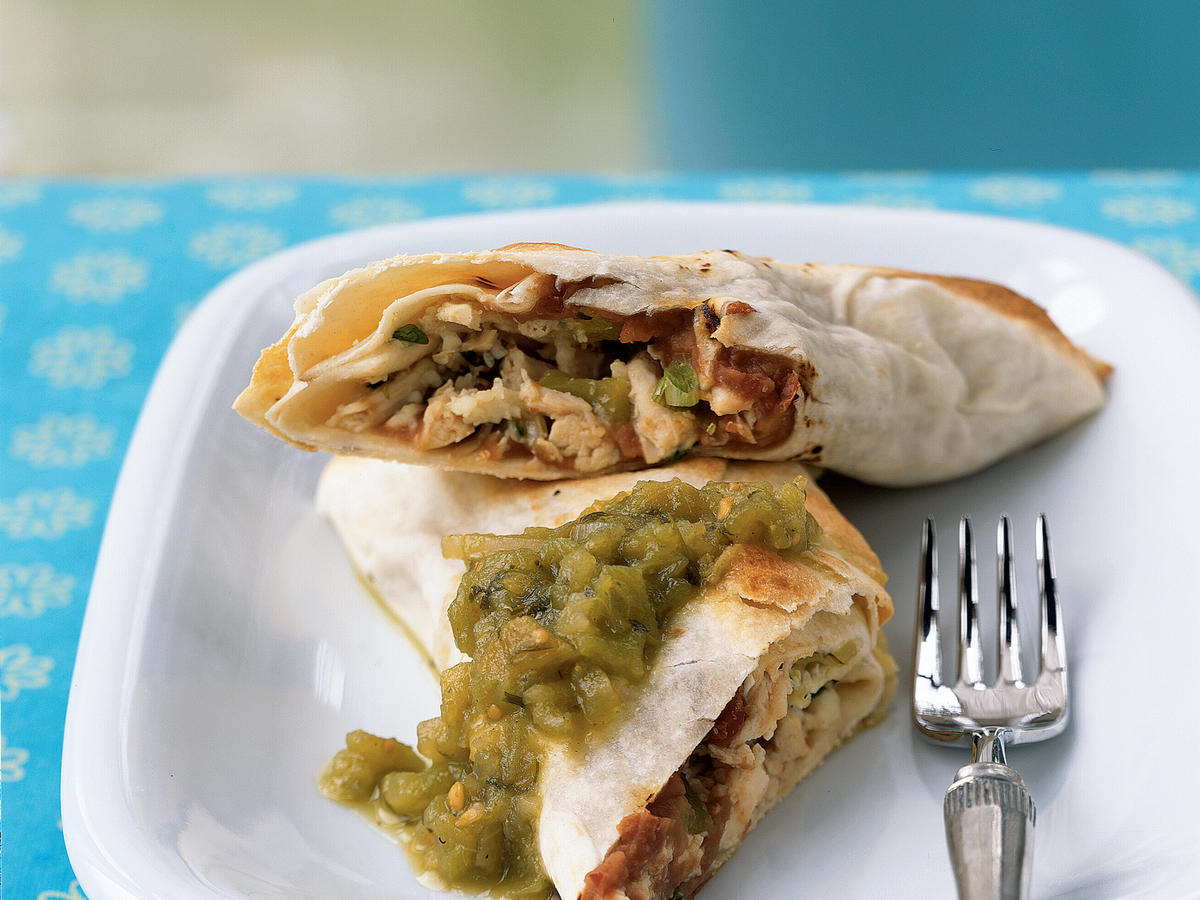 A few minutes in a blazing-hot oven gives these chimichangas the same browned, crunchy exterior as traditional deep-frying, but keeps the fat content under 10 grams each. A spicy filling with crumbly queso fresco contributes authentic flavor. A simple side salad topped with your favorite salsa makes a good partner to this dish.
