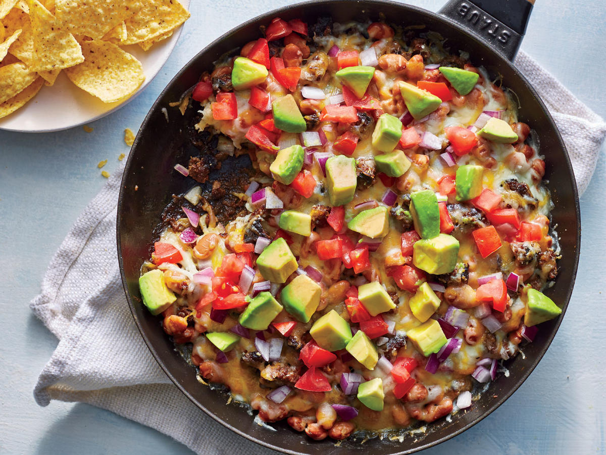 We combined our favorite elements of cheesy queso dip and loaded beef nachos into one epic skillet dish.