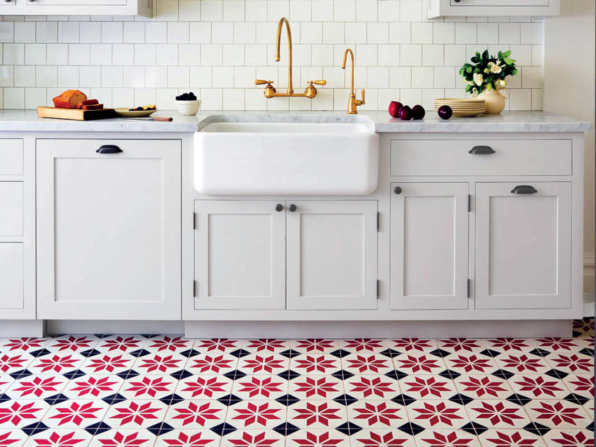 White Kitchen with Red and Blue Tile Floor