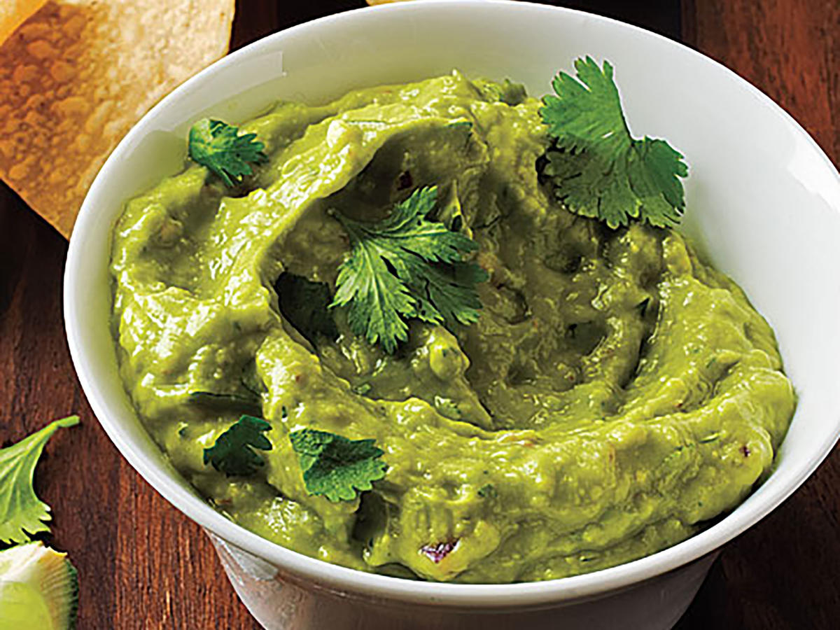 The name says it all—this is one of the easiest guac recipes you'll find. We turn to the food processor to speed up prep, allowing it to do the work of finely chopping onion, garlic, and jalapeño. Then soft, ripe avocado is added, and the whole thing gets blended until perfectly creamy. Sure, this is a pretty classic guacamole that's ideal for serving with tortilla chips, but you can also use this as your go-to spread for avocado toast. Get creative with avo toast toppers: You can try shaved radishes, carrots, or zucchini; crumbled soft cheeses or shaved firm cheeses; or charred corn kernels.
