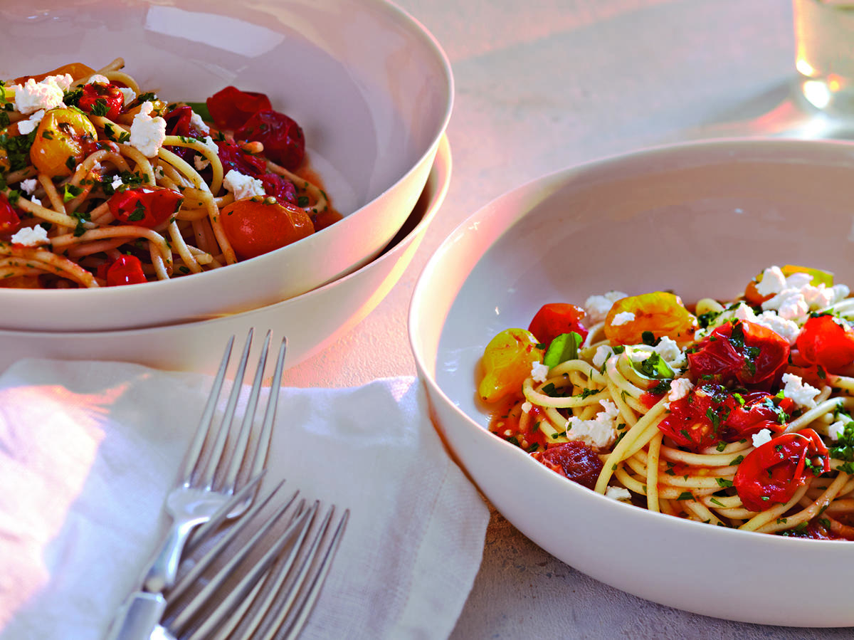 Make a quick fresh tomato sauce for this meatless pasta recipe by roasting cherry tomatoes and adding basil, parsley, and goat cheese to the dish.