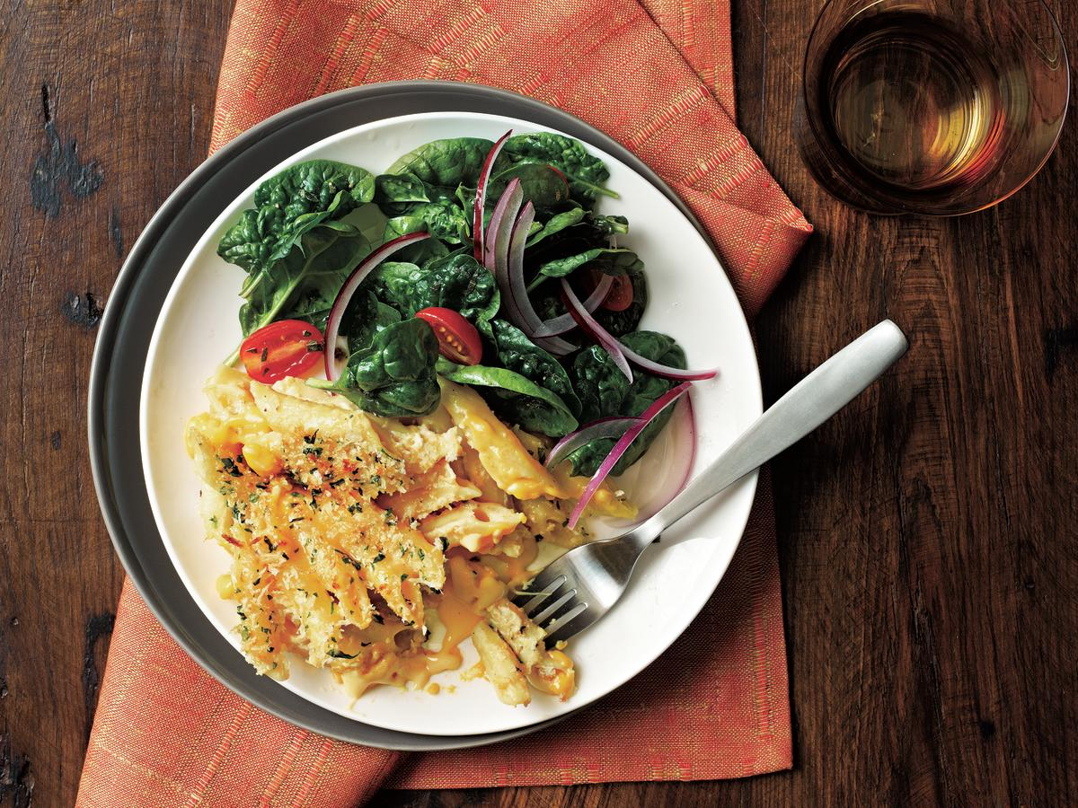 This baked macaroni and cheese casserole contains three different types of cheeses and a topping of crisp breadcrumbs. This dish has plenty of protein for a meat-free main dish.