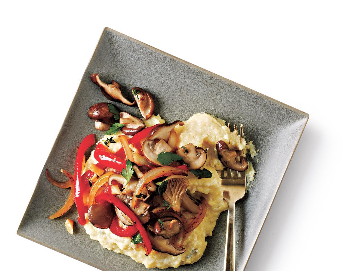 Savory blue cheese polenta topped with delicious veggies makes for a comforting and satisfying meal.
