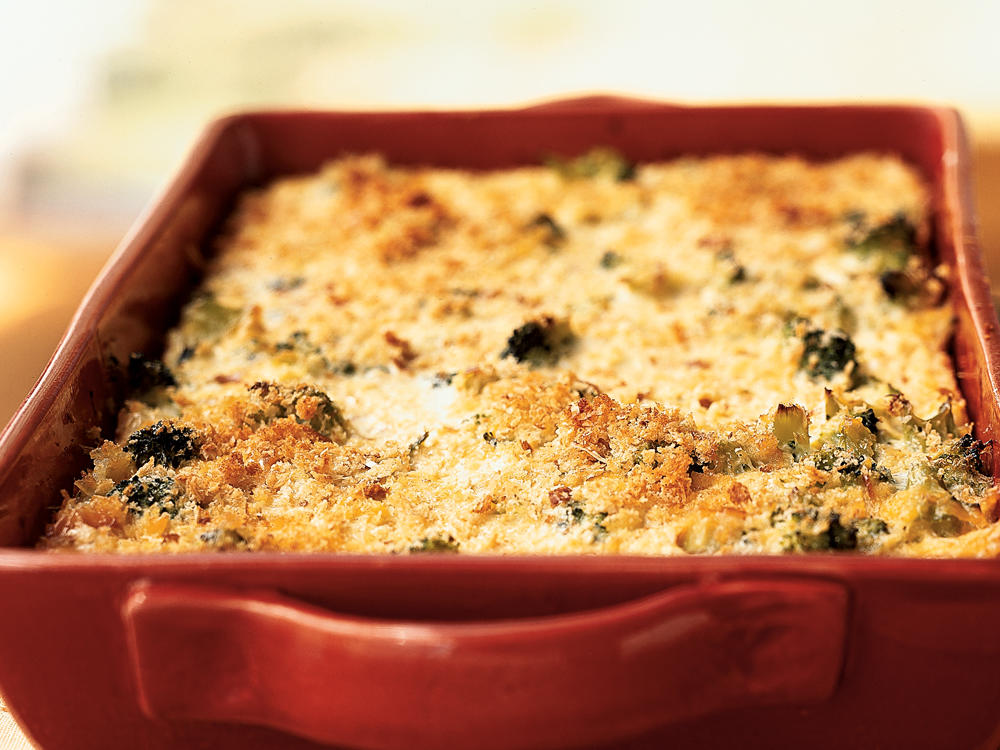 Broccoli remains slightly crisp in this recipe, though you can substitute any leftover cooked vegetables. Assemble the casserole the night before. Cover, refrigerate, and bake in the morning.