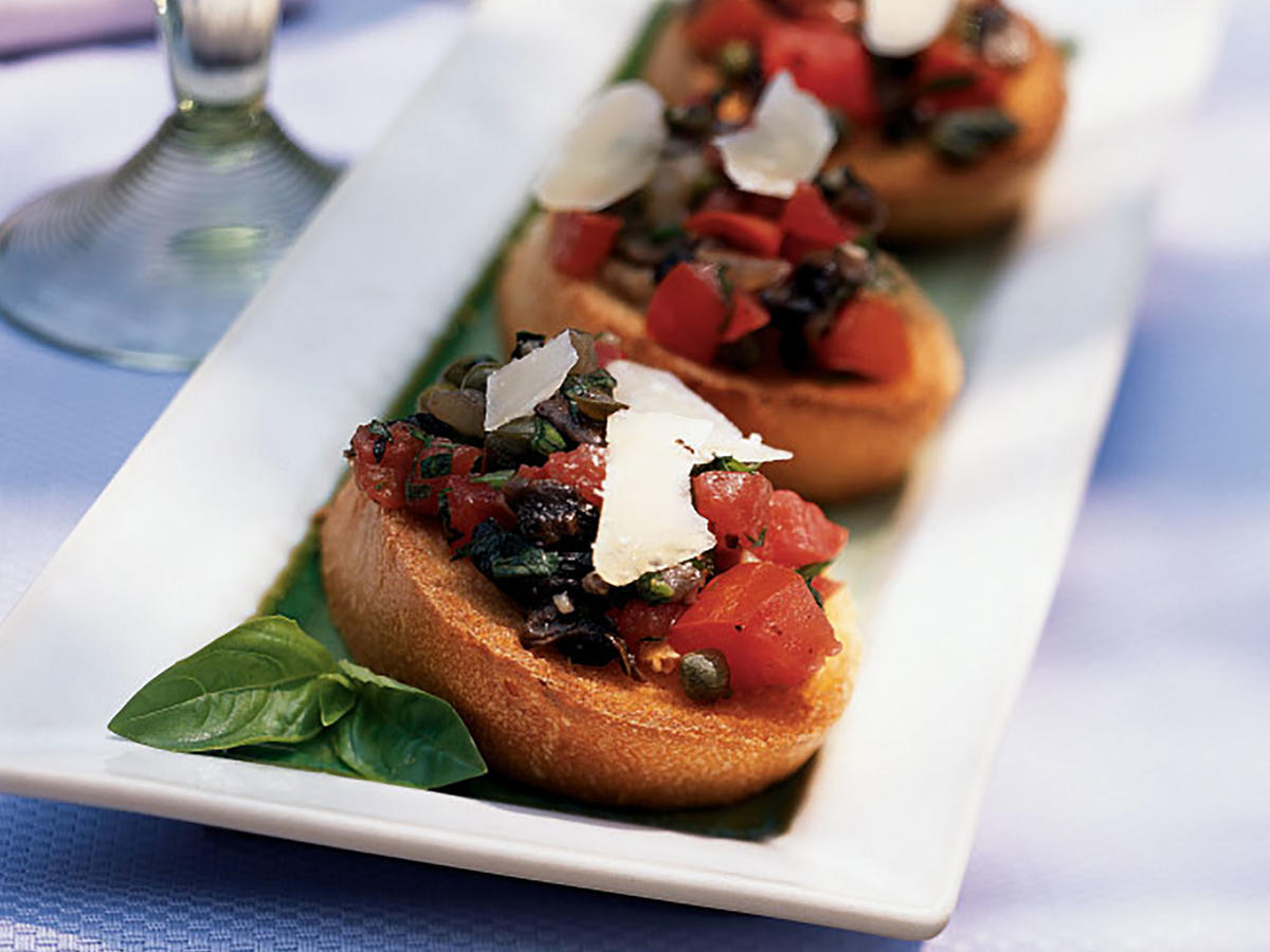 Classic bruschetta is great, but add a trio of meaty mushrooms to the filling and you have something extraordinary. We love the combination of shiitake, Portobello, and cremini, but you could use just one or two types. Skip white button mushrooms here—they won't have enough earthiness to stand up to the vinegar and crushed red pepper in the topping. Sautée the mushrooms to release their liquid and concentrate flavor; you'll know they're ready when the liquid has evaporated from the pan and the mushrooms are a deep golden brown. Use a vegetable peeler to shave the Parmesan into wide strips.