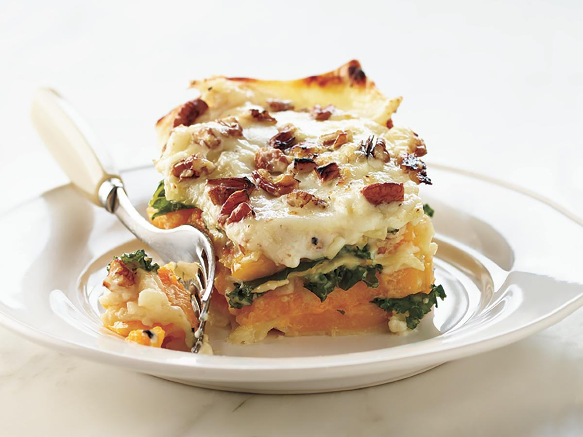 Gruyere-spiked Bechamel drapes over the noodles and squash to give this dish velvety richness. Hearty, earthy kale perfectly balances the sweet squash, and crunchy, toasted pecans crown the top of this luscious lasagna.