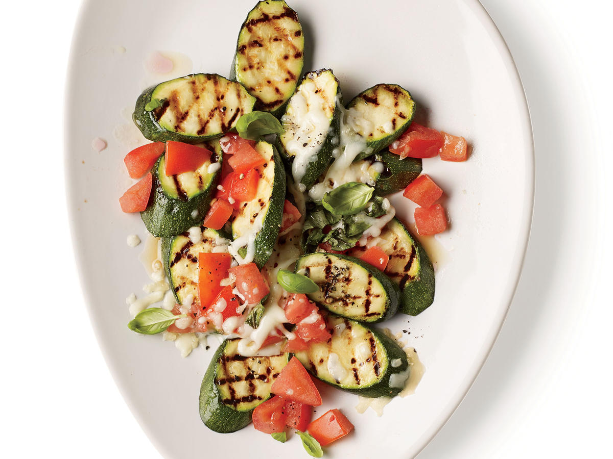 Give a summer dish some flair with this Italian-inspired super easy side. Grilling adds deep charred flavor to the zucchini, which pairs well with the bright tomatoes and creamy mozzarella.