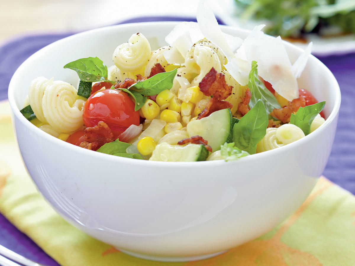 A light and flavorful pasta toss, accented with crumbled bacon, is a quick and easy dinner solution for any night of the week. Use whatever veggies you have on hand to add to the colorful dish. Serve with a mixed greens salad.