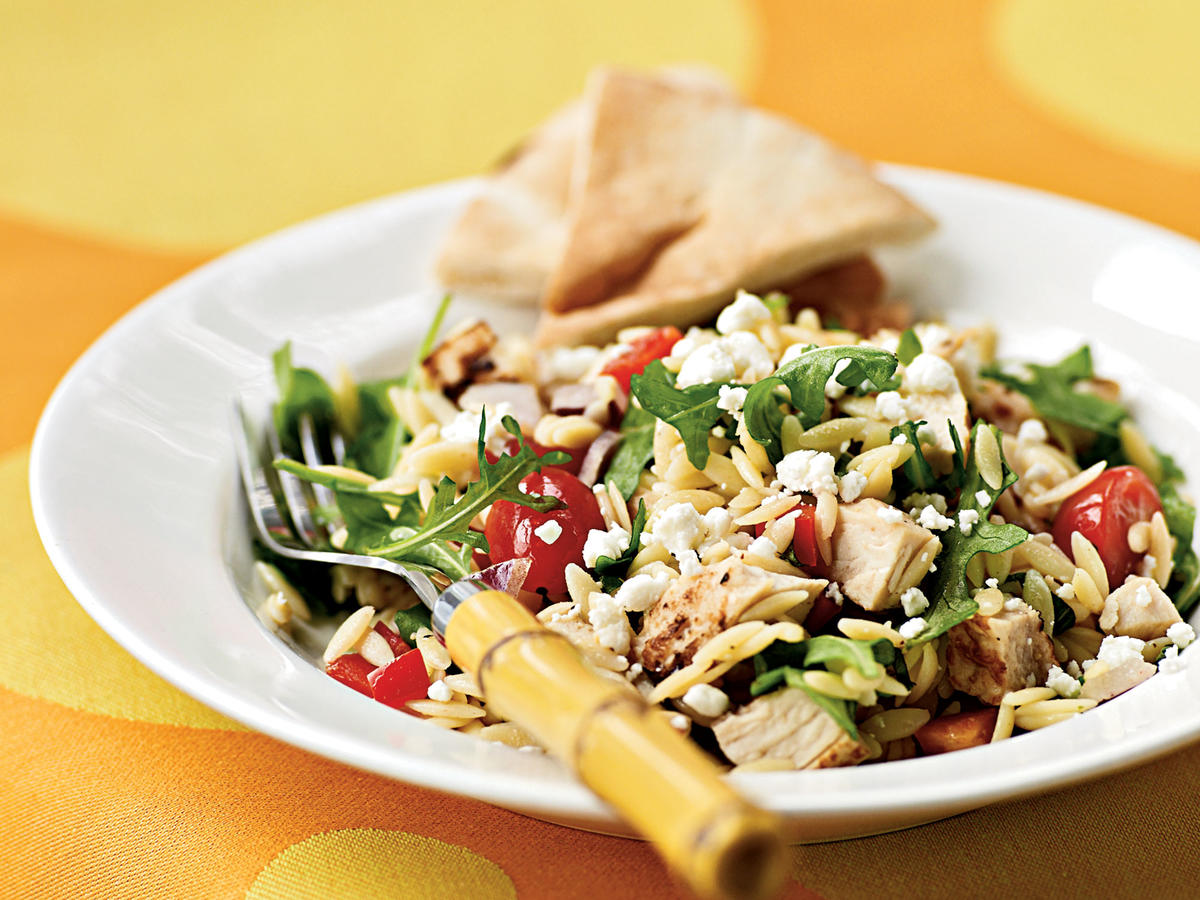 Main-dish salads with just greens can feel insubstantial at times, so this dish adds a base of orzo to fresh arugula, tomatoes, bell pepper, onion, and basil. Tangy goat cheese gives a luscious creaminess to each bite, and chopped chicken makes for a filling meal. Leave out the chicken and double the other ingredients for a picnic pasta salad that'll drive guests wild.