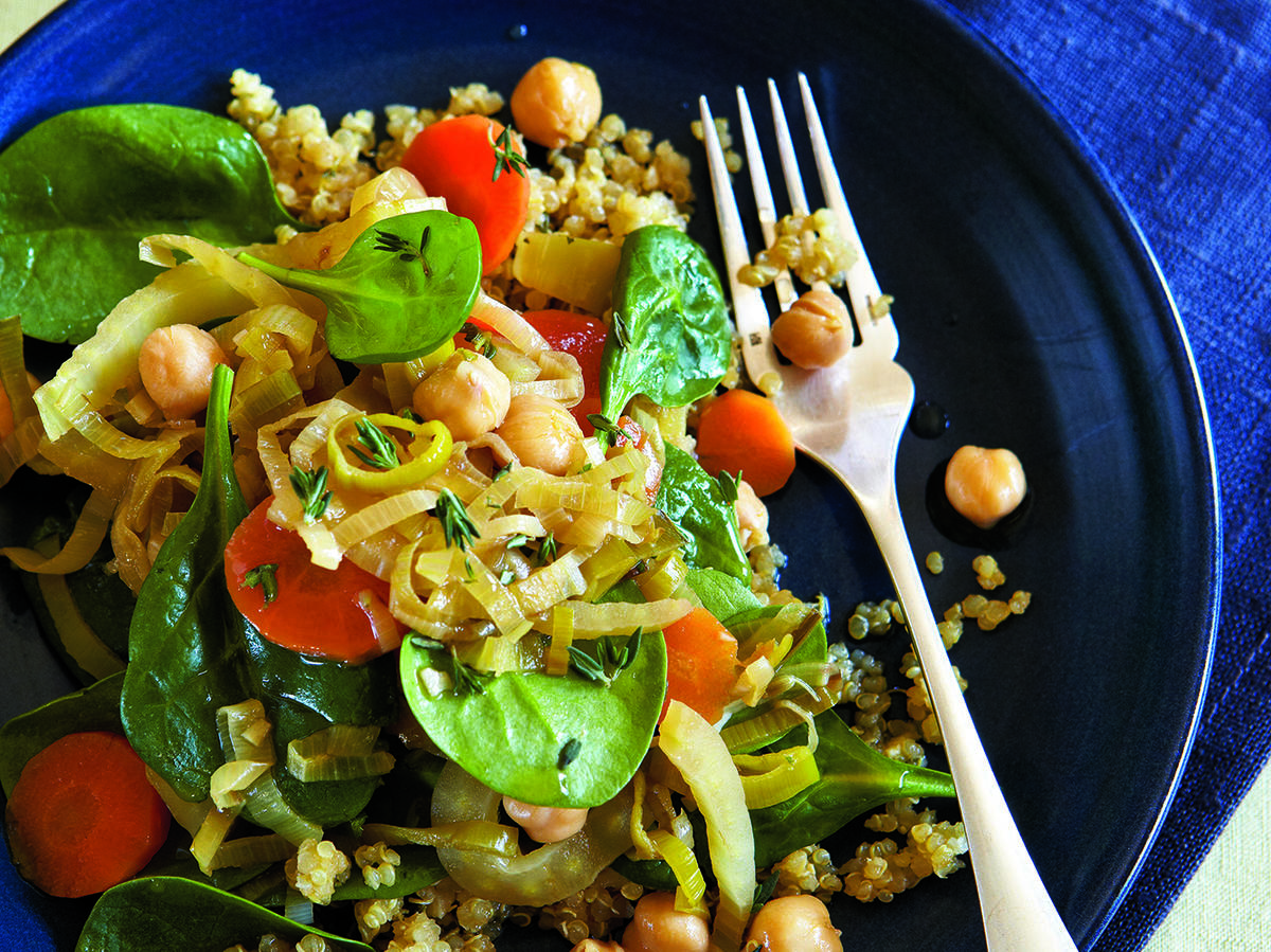 Bajane is a Provençal term for the midday meal. Chickpeas are a staple in Provence, where they are often stewed and served with pasta and vegetables. In this version, chickpeas, leeks, carrots, fennel, and spinach are served atop protein-rich quinoa.