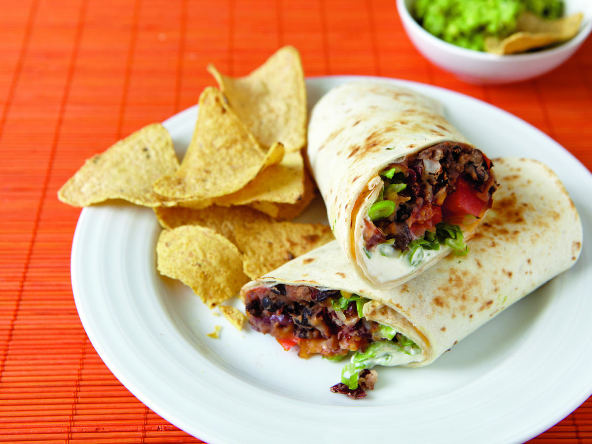 Add guacamole and chips to this hearty vegetarian dish for an easy Mexican meal.