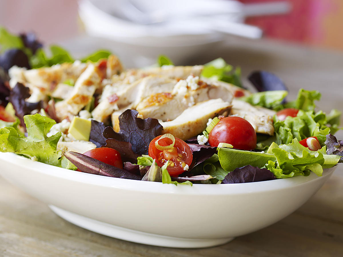 With plenty of chicken, creamy avocado, bacon, and blue cheese, this is the classic entrée salad. Bottled Italian dressing cuts down on time (the whole recipe, including cooking the chicken, takes less than 15 minutes). But if you like, you can whip a quick low-fat vinaigrette for that homemade touch.