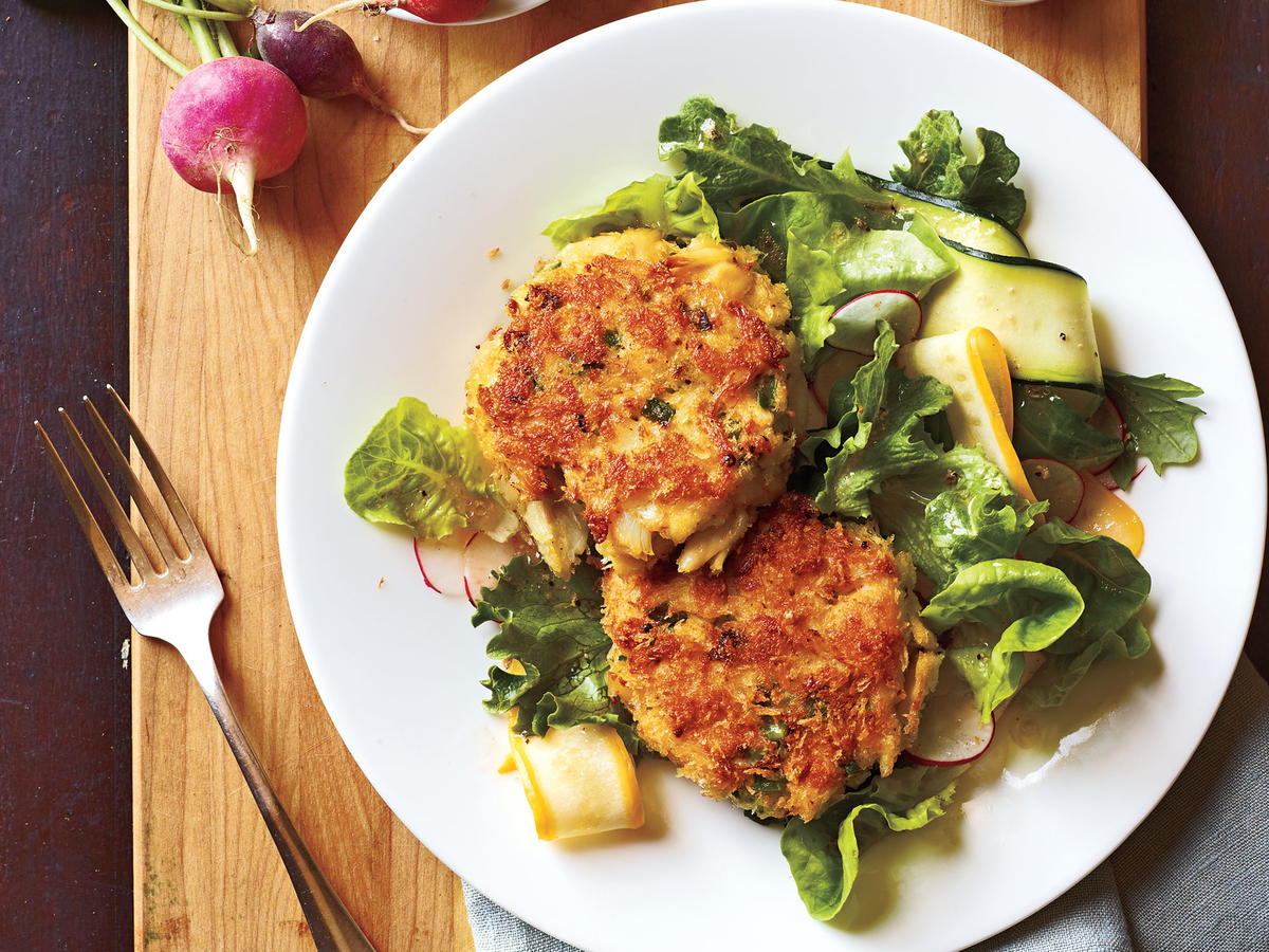 "You don't have to be in Maryland to enjoy delicious crab cakes. You can make them in your own kitchen and serve over mixed greens with a side of this must-have rémoulade. Succulent crab, combined with crunchy panko crumbs, and crisp onions and peppers are the secret to our signature crab cakes. Cooking Light Editor Scott Mowbray raves, ""These are the best crab cakes we've ever made!"""