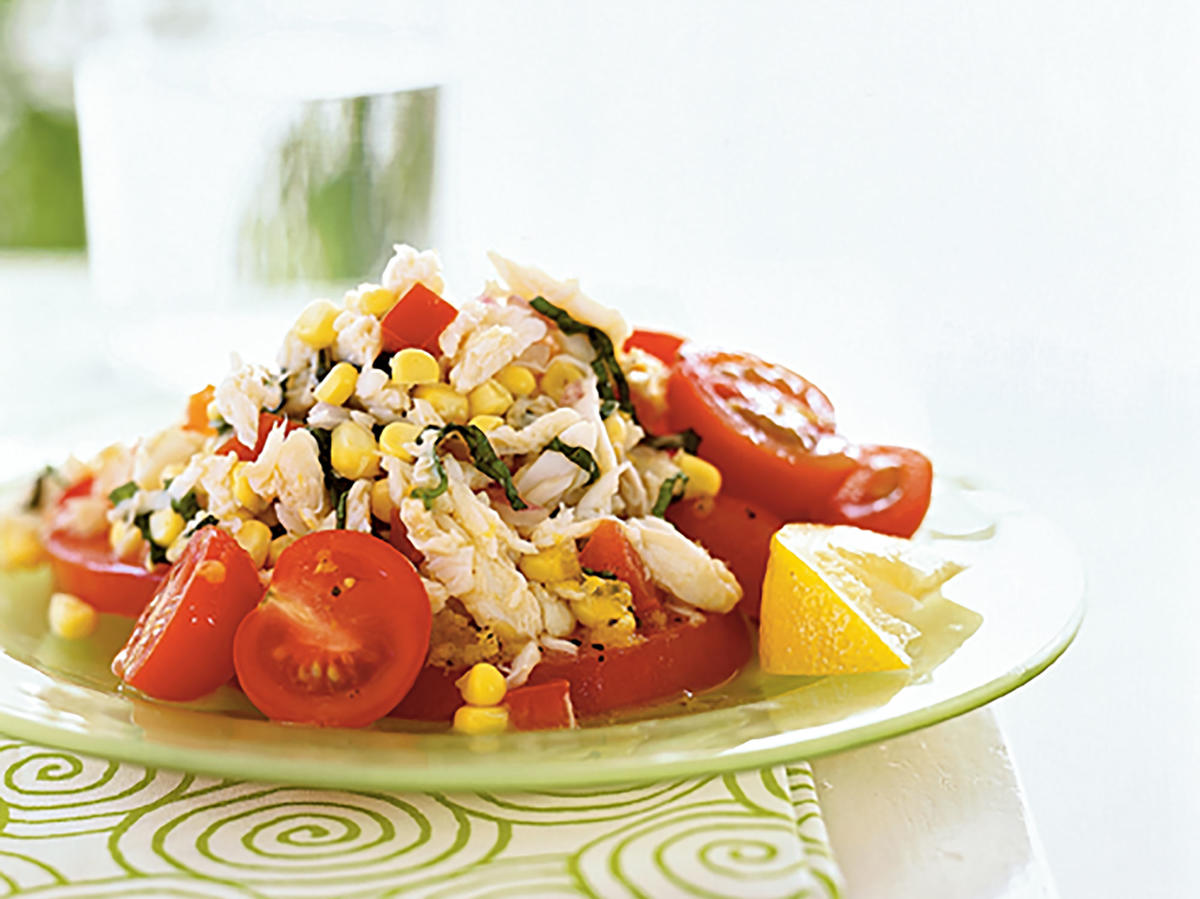 This dish looks super-summery: It's just a heaping helping of fresh vegetables mixed with delectable crabmeat in a lovely light dressing. Show off your own garden by adding other fresh veggies like zucchini or green beans. If you don't like crab, try chopped chicken or canned tuna or salmon instead.