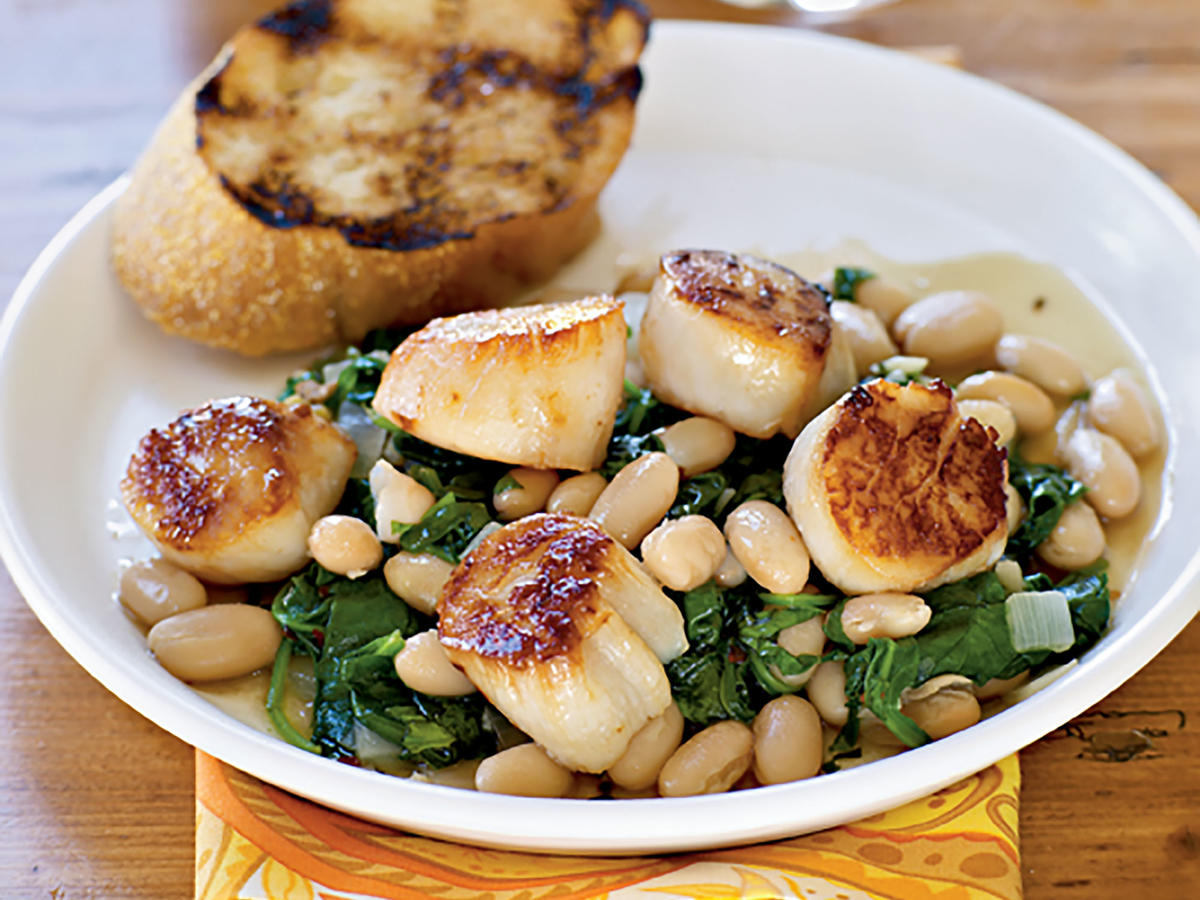 Pair this one-dish seared scallops meal with a side of garlic bread. It's perfect for sopping up every last drop of the delicious sauce. The iron in spinach and protein in the beans and scallops make this a perfect alternative to a red meat meal.