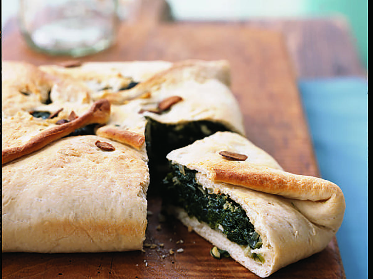 This updated, one-dish casserole is a cross between a vegetarian calzone and the classic Greek dish spanakopita.