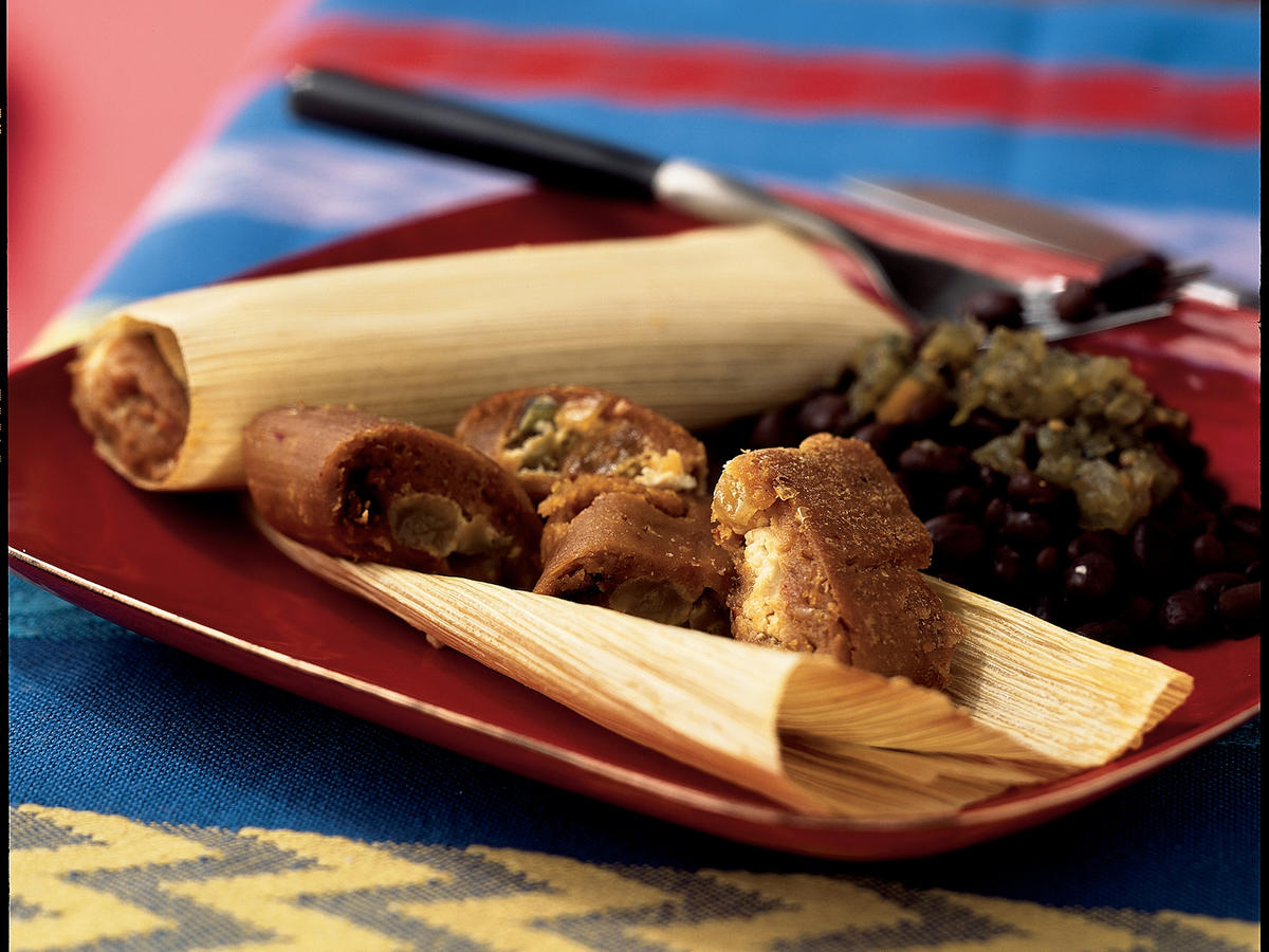 A couple of these meatless, sweet-savory tamales make a nice entrée with a salad or black beans. To make these tamales vegetarian, prepare the Basic Masa Dough with vegetable shortening instead of lard.