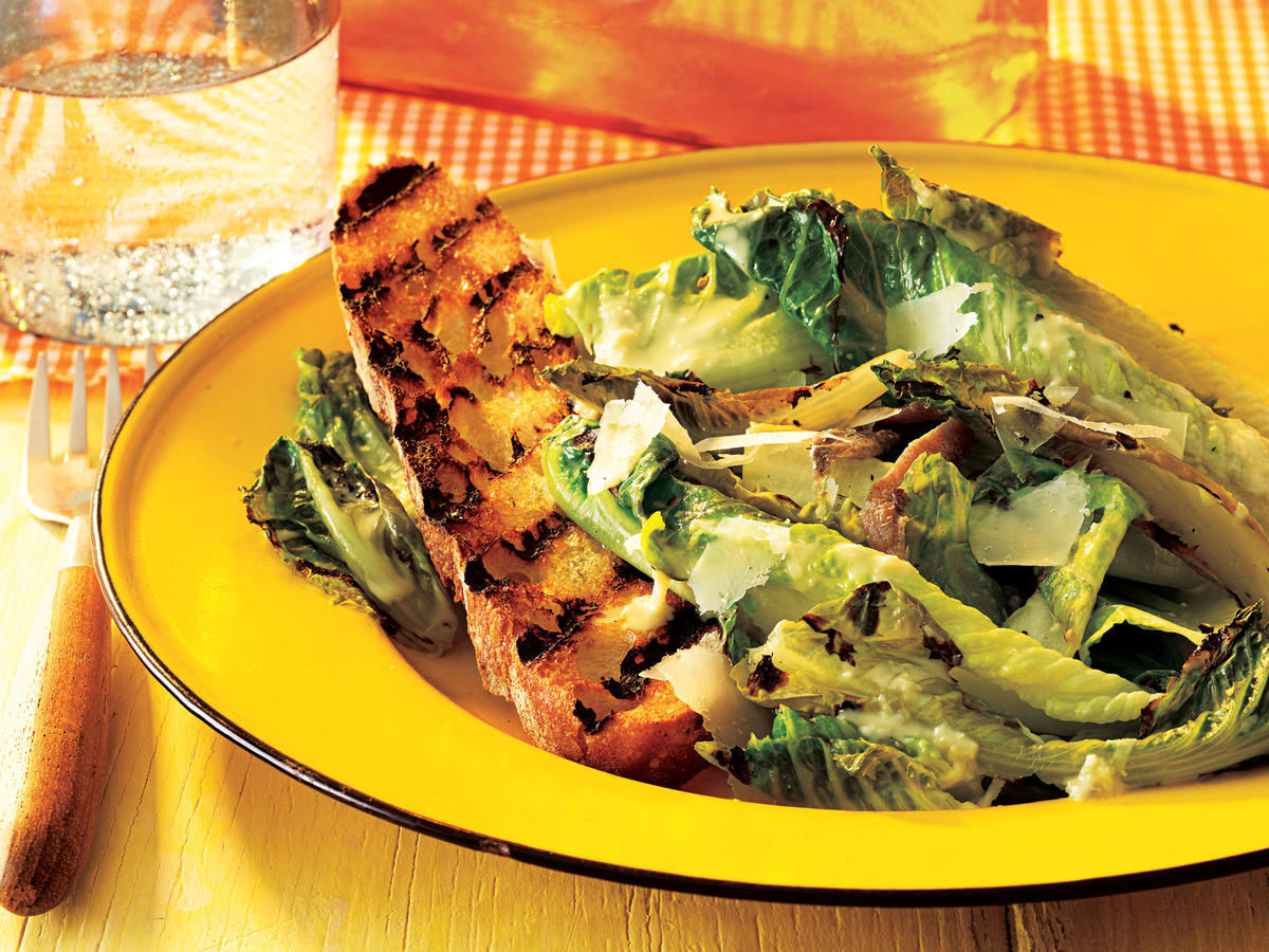 Grilling lettuce gives it a hint of smokiness and lends the leaves crisp-tender contrast. Toasted garlic bread stands in for croutons.