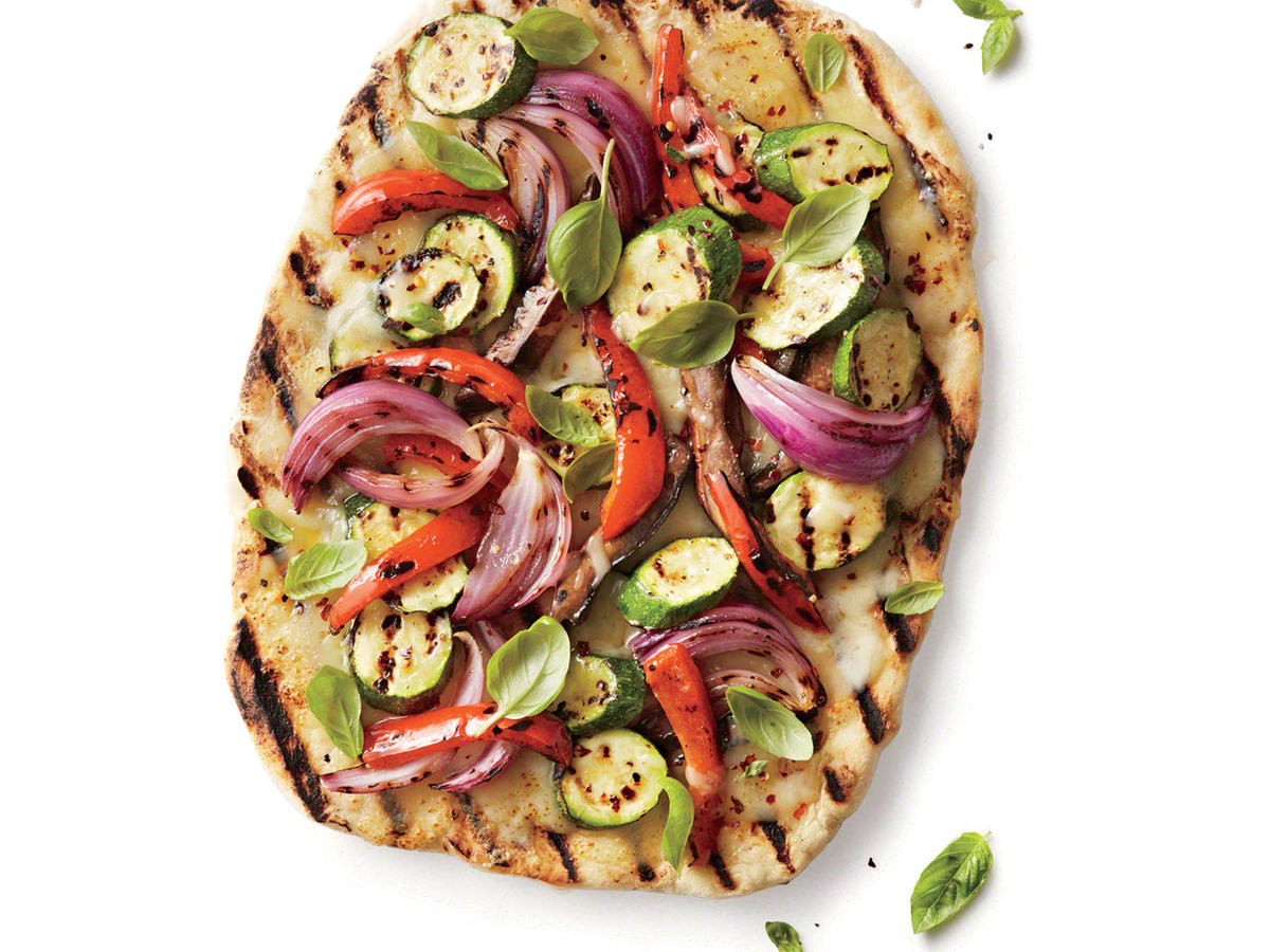 This grilled veggie pizza is a gorgeous medley of red pepper, zucchini, mushrooms, red onion, and sweet basil. Also consider orange, yellow, or purple sweet peppers such as Merlot, Golden Treasures, or Canary Bell. With refrigerated fresh pizza dough and a few minutes on the grill, dinner is on the table in no time.