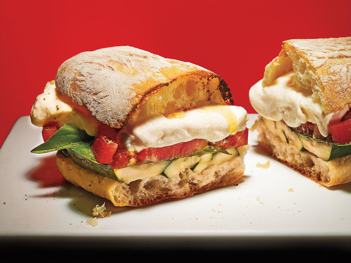 The classic Caprese salad of juicy tomatoes with fresh mozzarella and fragrant basil makes for a fantastic vegetarian sandwich. We've added grilled zucchini to up the game. Gooey mozzarella puts it over the top.