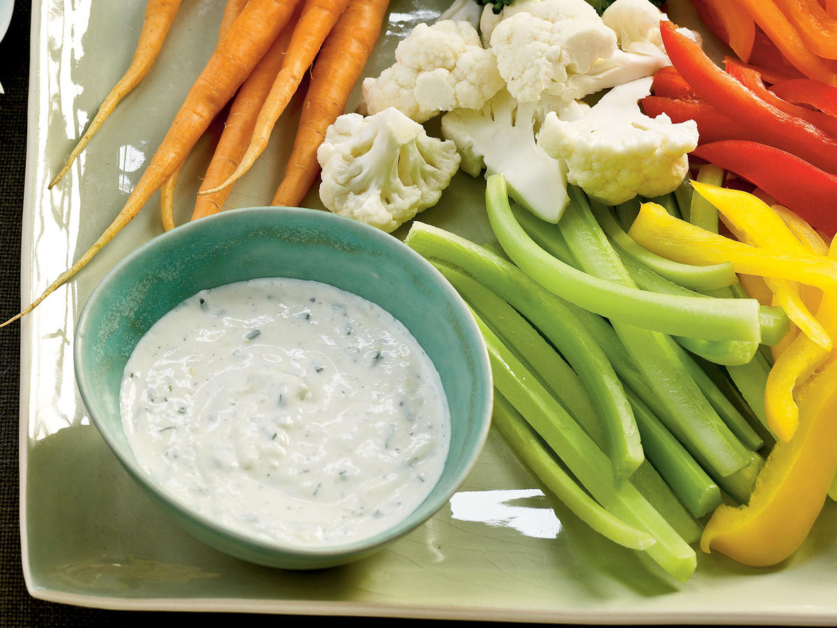 Everyone needs a great, dependable, simple dip recipe to put out with crudités. Done—this is the one. It's like a much fresher version of ranch dip, one that's creamy, rich, and flavored with fresh herbs and a hint of garlic. We call for a small clove of garlic because it's left raw and is therefore at its most pungent; you can grate it on a Microplane-style grater for a smooth garlic paste that incorporates well into the dip. You can prepare the all-purpose dip up to a day ahead, making this appetizer a quick fix for hungry guests.