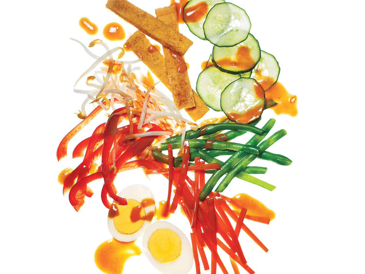 This is a simplified version of the splendid Indonesian salad called gado gado, which along with satay is practically a national dish, often served with crunchy shrimp crackers. It uses shortcut ingredients in the sauce—peanut butter, curry paste—to speed things along. For a spicier dressing, stir in sambal oelek or Sriracha.