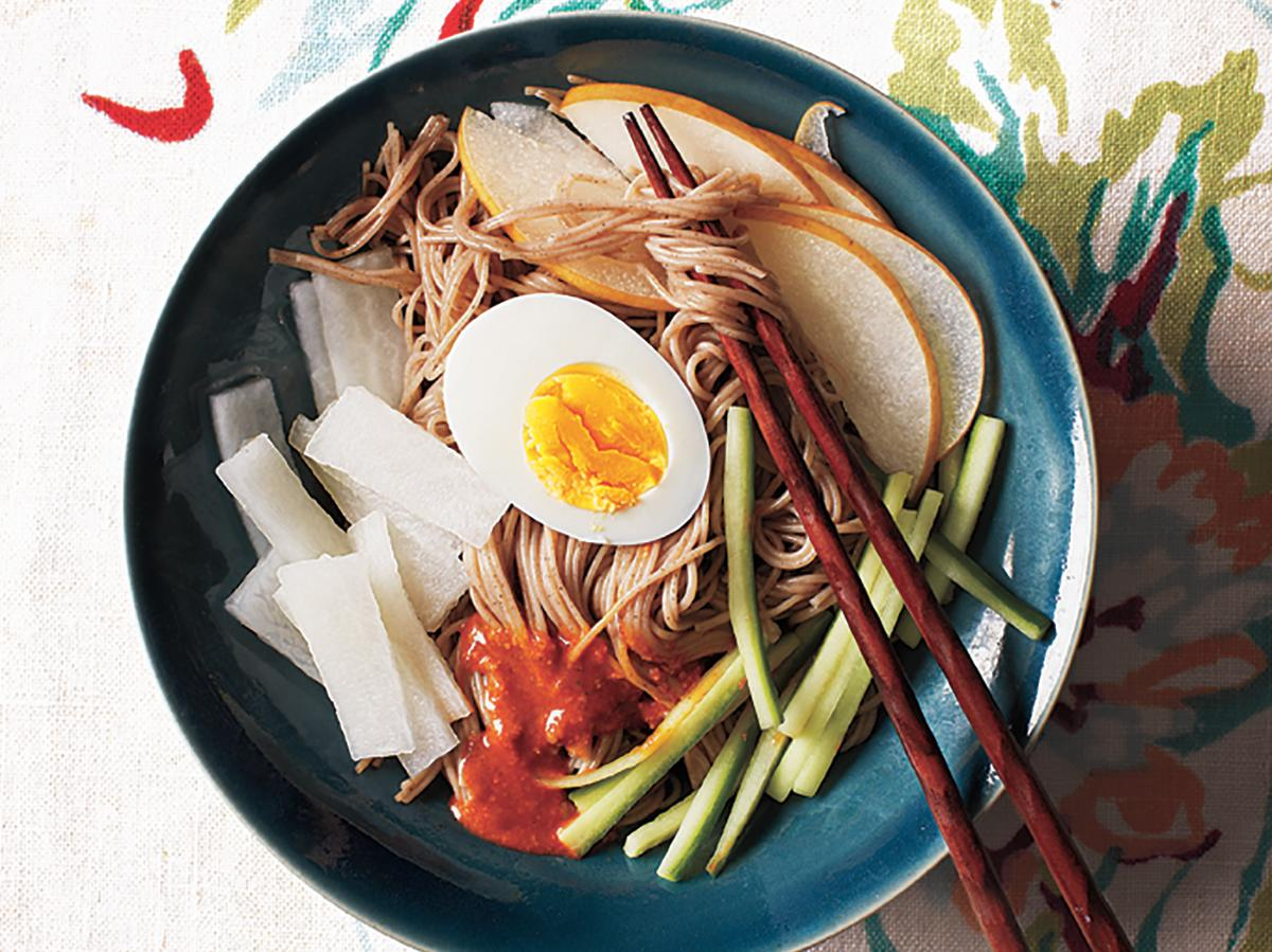 This dish is most popular in the summer but delicious year-round. Korean naengmyun noodles are made from wheat and buckwheat and are wonderfully chewy; Japanese soba is an adequate substitute but lacks the chewy texture. Because of the noodles' firm texture, the dish comes to the table with scissors, and you are to snip a few times and then mix everything together after enjoying the initial presentation.