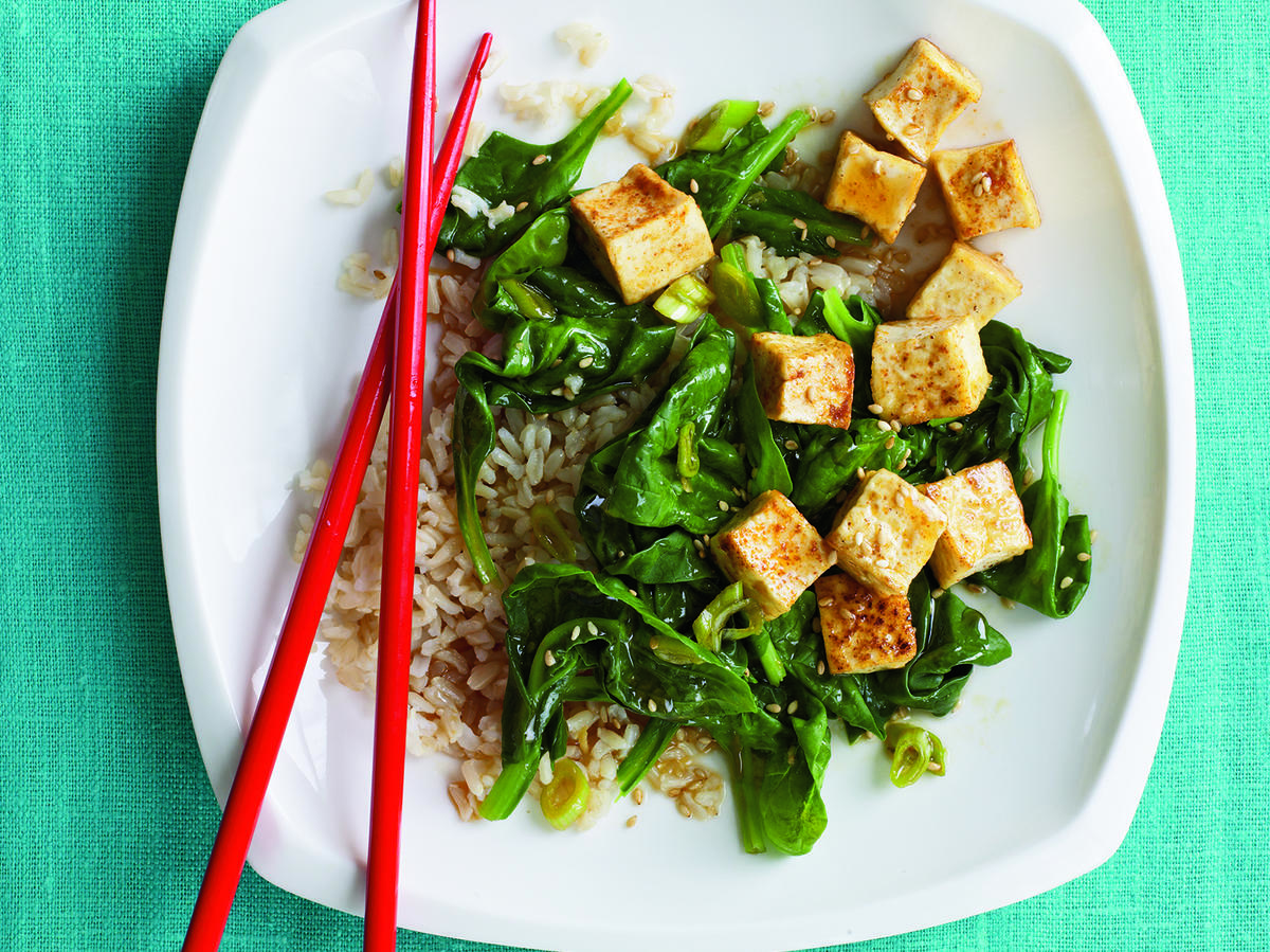 Draining and pressing the tofu yields a crisp crust when pan-fried; it also helps the tofu absorb more flavor from the zesty pan sauce.