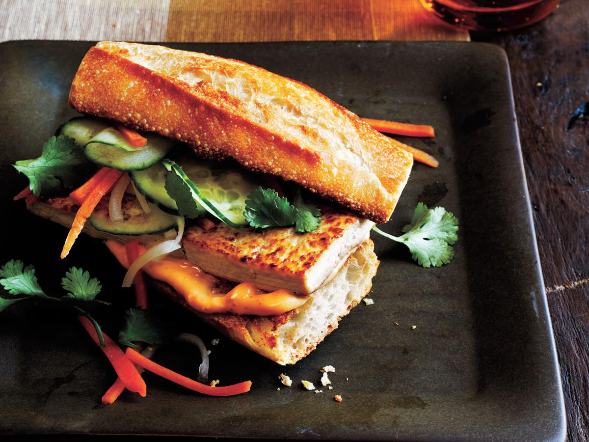 The bread and Vietnamese filling—carrot and radish, cilantro, mayonnaise, and cucumber—are traditional in this vegetarian take on the classic. Prepare mayonnaise mixture and toast bread while the tofu and vegetable mixture marinate.
