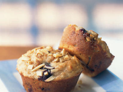 "We call these ""power"" muffins because they're loaded with B vitamins from whole wheat flour, calcium from milk and yogurt, antioxidants from blueberries, and heart-friendly monounsaturated fat from almonds and canola oil. You can freeze the muffins for up to a month, then thaw them at room temperature, or microwave each muffin at HIGH 15 to 20 seconds—making them an ideal grab-and-go morning option."