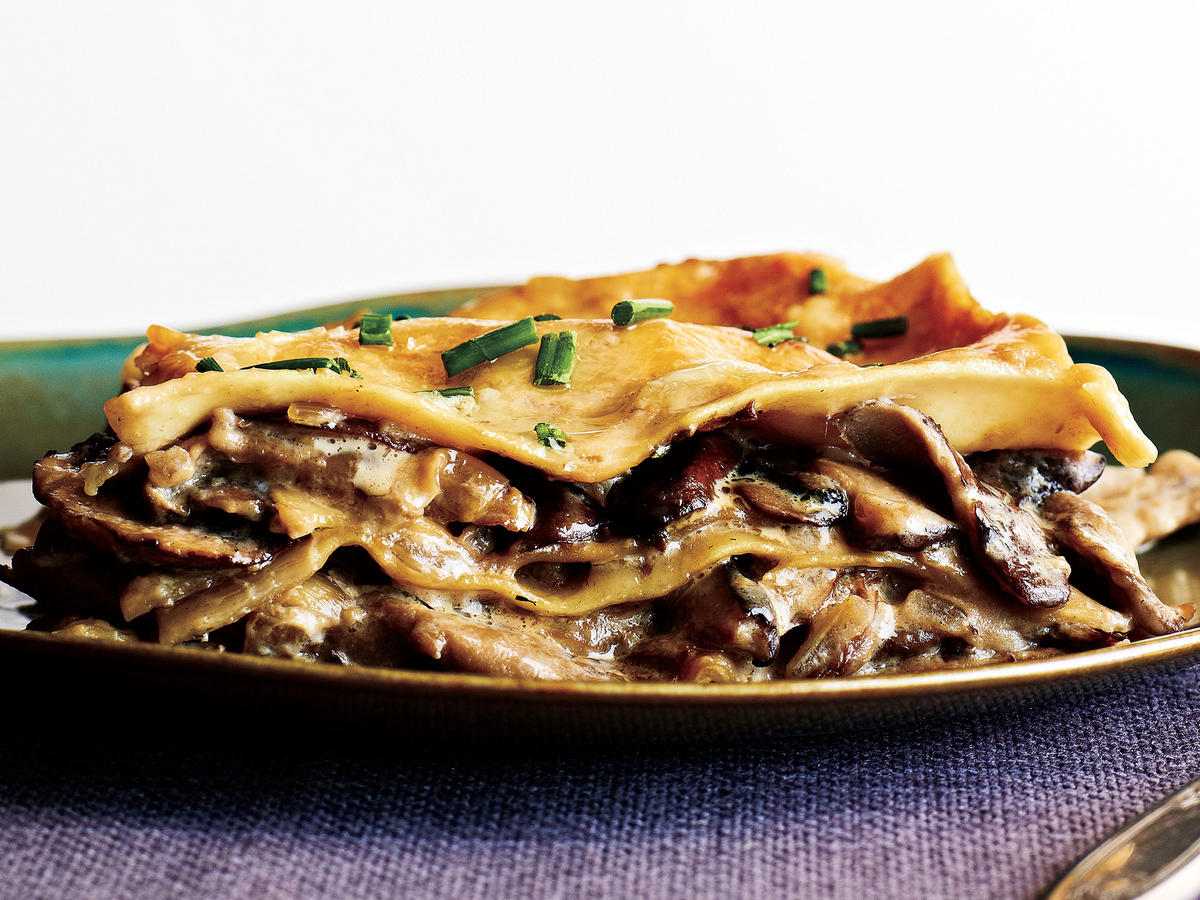 Rich porcini broth and nutty Parmigiano-Reggiano add deep umami taste to this vegetarian lasagna. Plain white button mushrooms will work in place of cremini. Serve with a simple green salad for a satisfying meal.