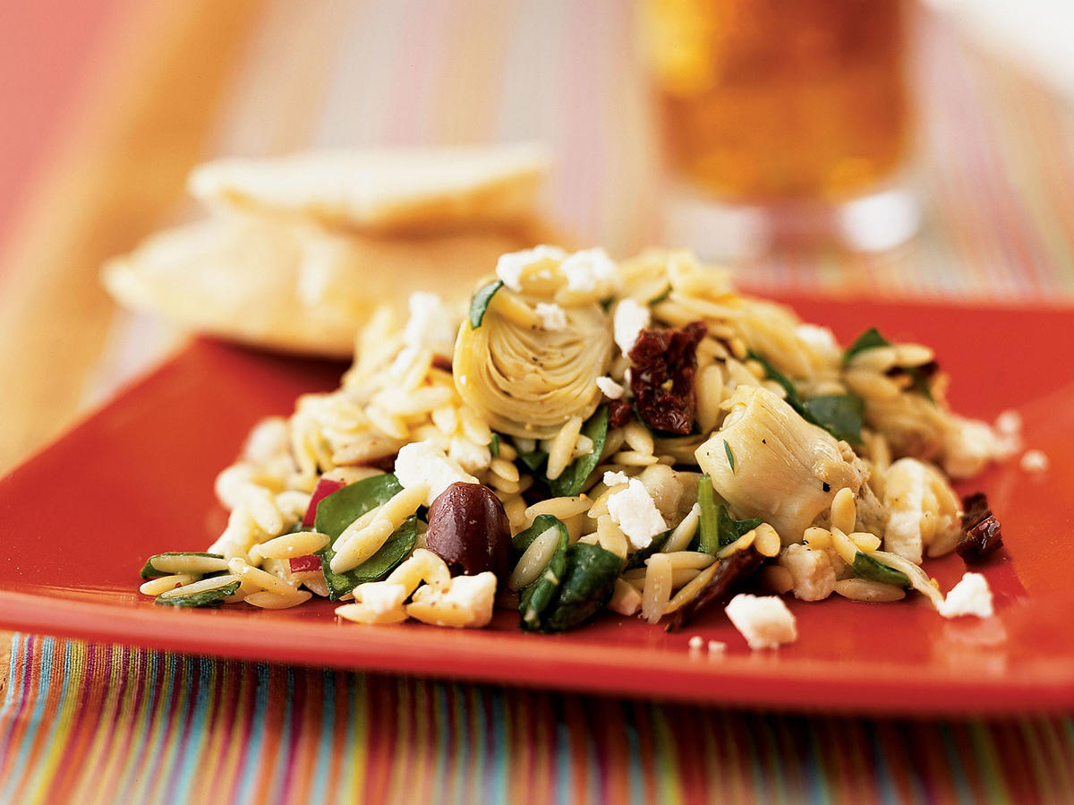 Orzo pasta is a versatile base for dishes, and this one is chock-full of zesty ingredients. Red onions add crunch and the combination of artichoke hearts, feta cheese, and kalamata olives all add fresh brininess to the salad.