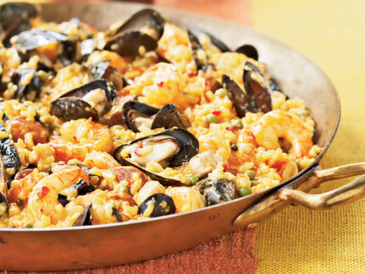 Valencia is a Spanish coastal city where this dish is particularly revered. Sausage and chicken combine with seafood and veggies in this traditional gourmet production.