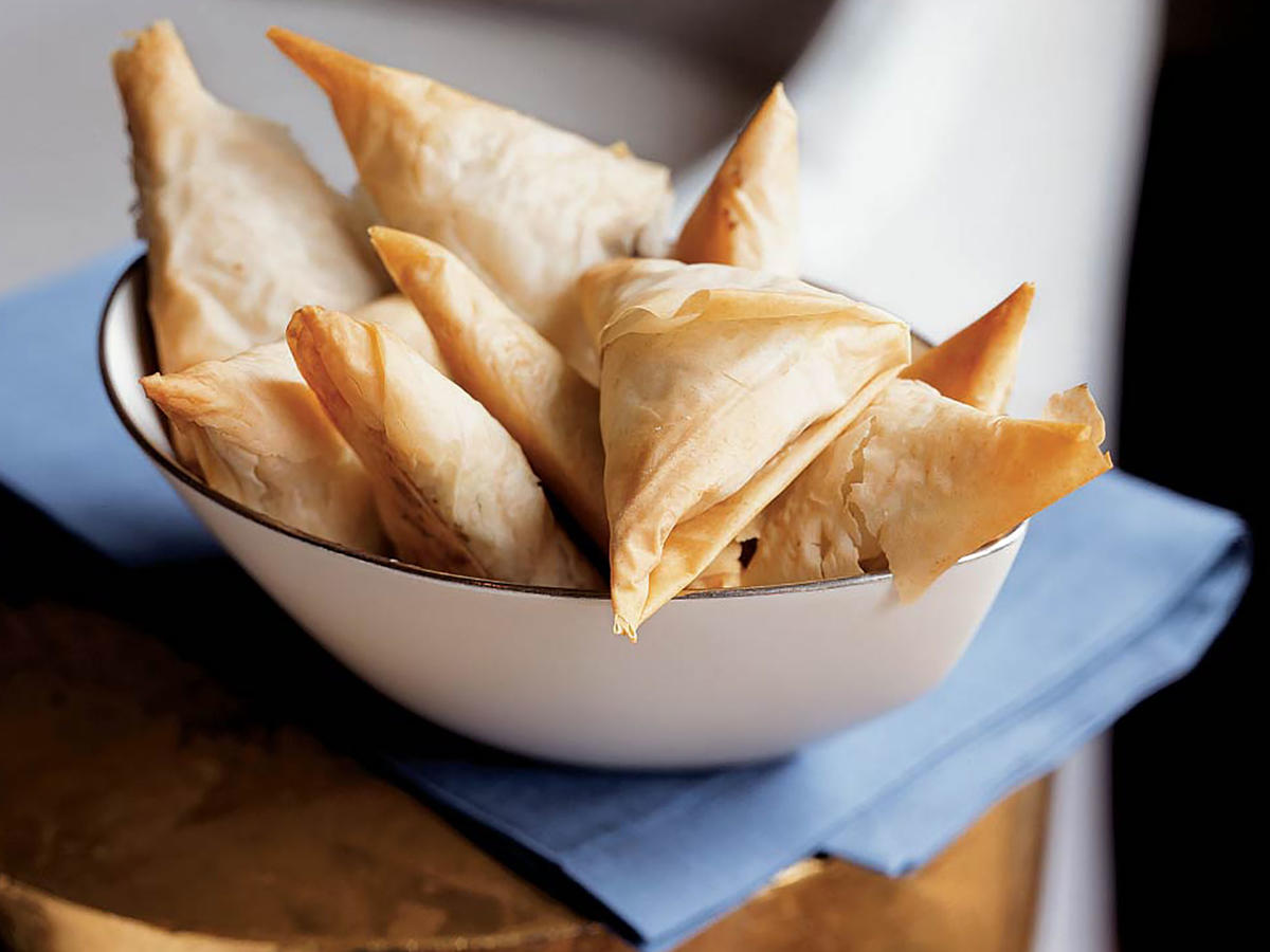 At only 25 calories each, these crispy-creamy triangles feel like a miracle. The delicious flavor depends on dried porcini mushrooms, which give the filling an intense and concentrated mushroom flavor. Be sure not to leave them out. You might find dried porcini in different places in the supermarket—check near the fresh mushrooms in the produce section, or on the shelves near the pasta and Italian foods. You can assemble and freeze these up to two weeks in advance (a good weekend project), then pop them into the oven and add seven minutes to the cook time (no need to thaw). The savory mushroom filling and the feathery phyllo will impress all your guests.