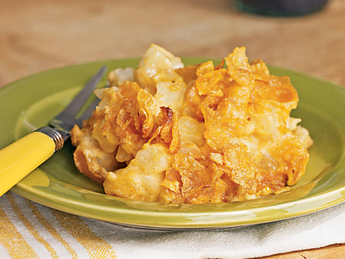 This simple hash brown casserole features a buttery cornflake crust and is a favorite side for both casual family gatherings and holiday celebrations.