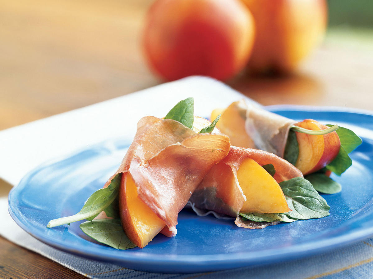 These wonderful bites are truly perfect for unexpected guests; they take all of two minutes to put together and use one of the season's best fruits. They also use just five ingredients (including olive oil and black pepper) and are gluten and dairy-free. If you have vegetarians at your gathering, skip the prosciutto and stack the basil and nectarines on crackers with sliced fresh mozzarella. Stone fruits and pork products pair extremely well together, so you also could use plums, peaches, or apricots with slices of ham or salami. Arugula provides crunch and pepperiness to contrast the rich prosciutto and sweet fruit.