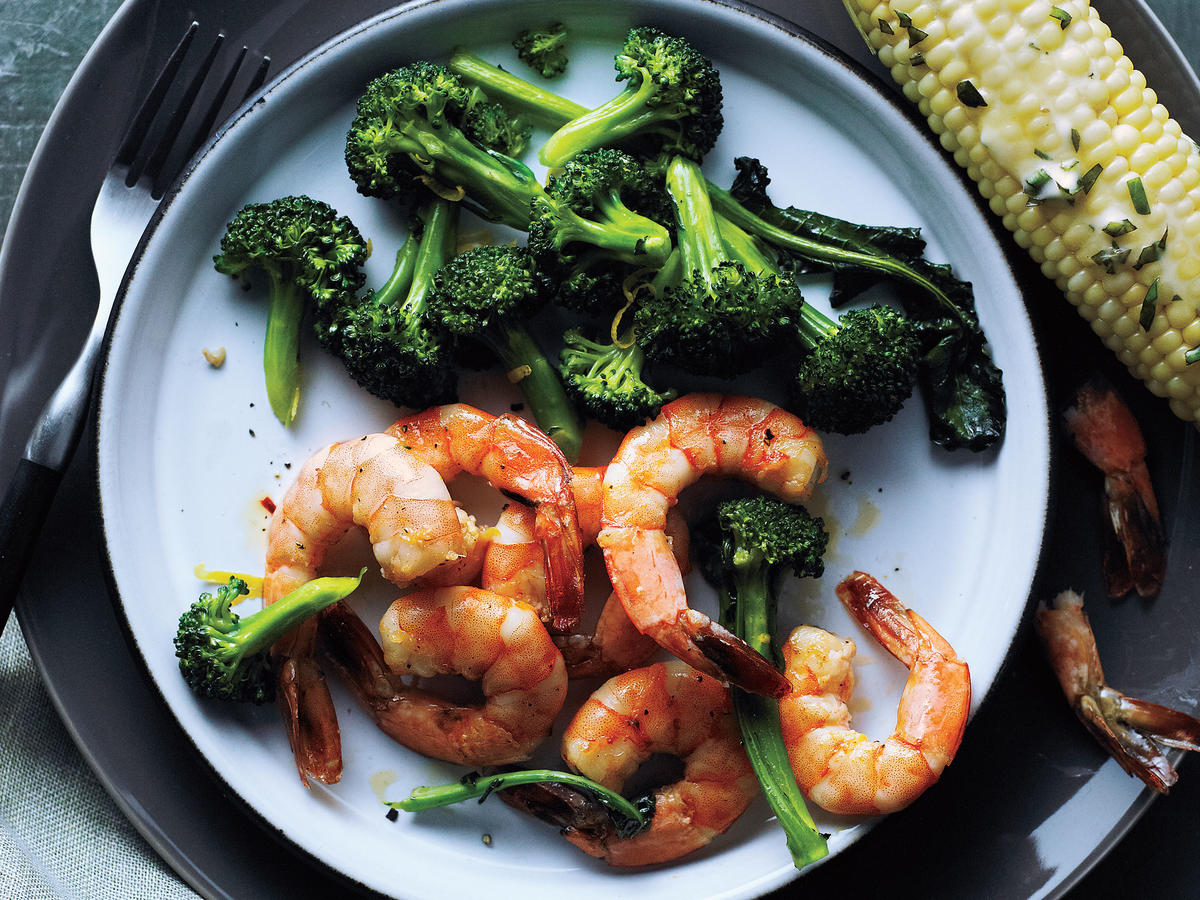 Busy night? No problem! This quick, lean dinner whips up in just 15 minutes, so you can keep the boxed and frozen dinners on the shelf and off your plate. This easy baked shrimp recipe pairs perfectly with the broccoli, but would also be perfect paired with a simple veggie toss, a crisp salad, or loaded into a lettuce wrap. Once you have a few clean-eating staples down, creating a week's worth of menus is a breeze. Shrimp are an often forgotten protein, but they're budget friendly and quick cooking, making them high on our go-to weeknight meal rotation list.