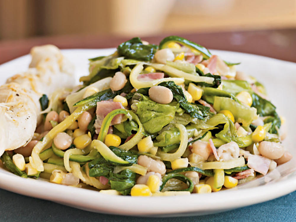 Though often used as a salad green, escarole benefits greatly from a quick sauté in this light main-dish salad. With white beans for body (and a big nutritional punch), pancetta for meaty flavor, and zucchini and corn for freshness, this dish makes a great choice for a home-cooked dinner on a busy night.