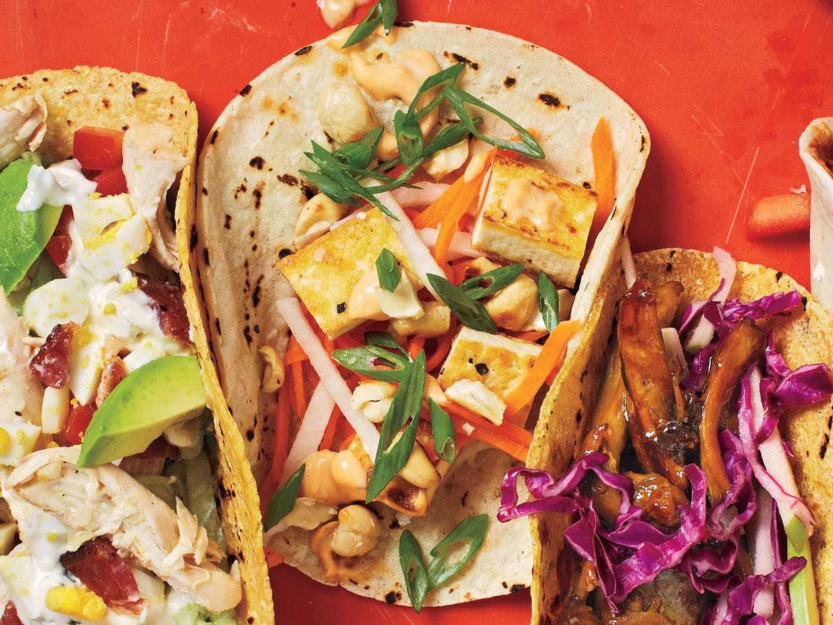 Pickled daikon radishes and carrots plus a spicy Sriracha sauce set these Asian-inspired tacos apart. Pan-sautéed cashews lend meaty crunch to this vegetarian dish.