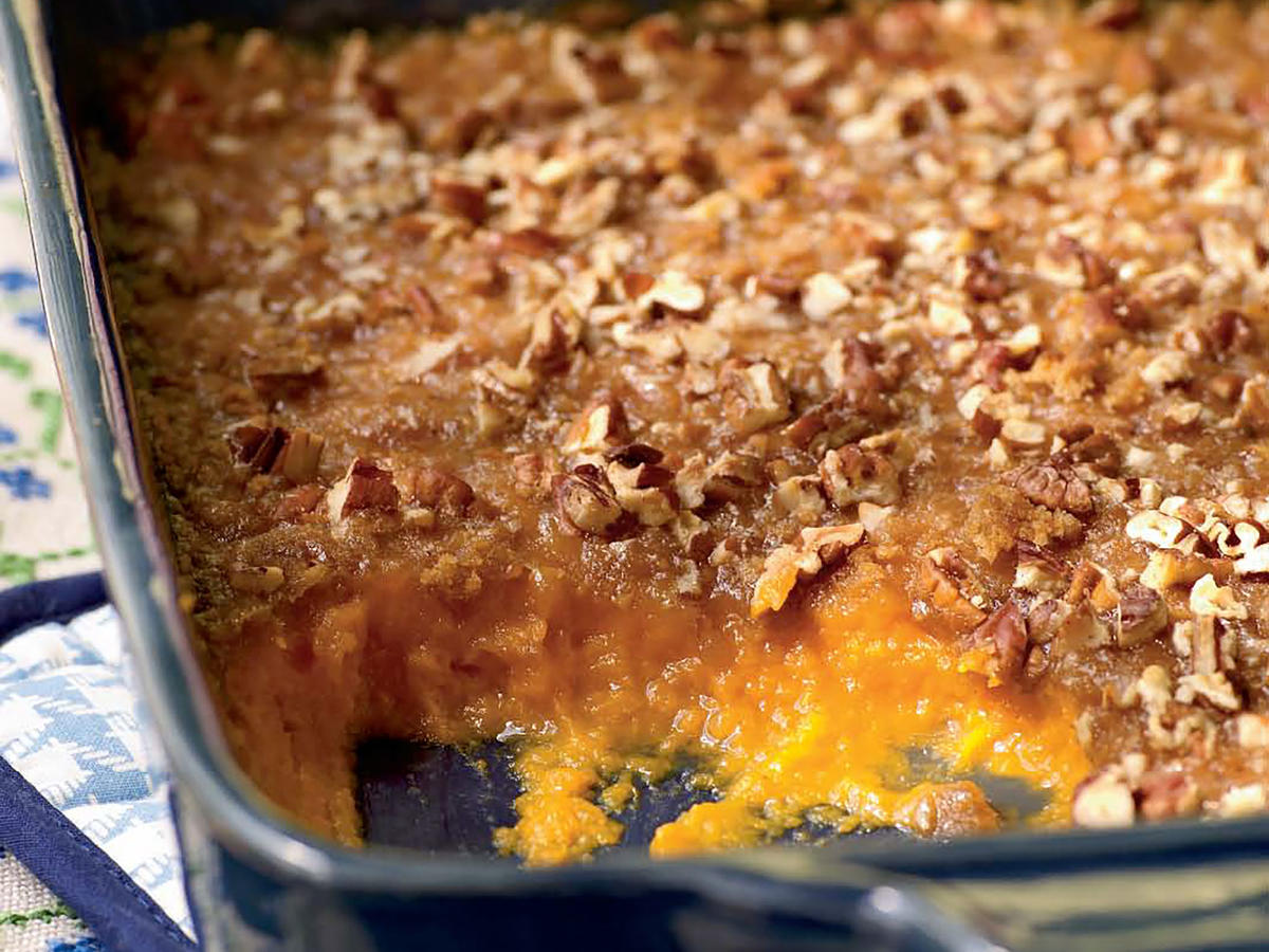 This side is ridiculously easy and goes into the oven in only 10 minutes, thanks to sweet canned yams. To boost flavor and add richness, we counter the canned spuds with luscious crème fraiche; chunks of almonds bring big crunch.