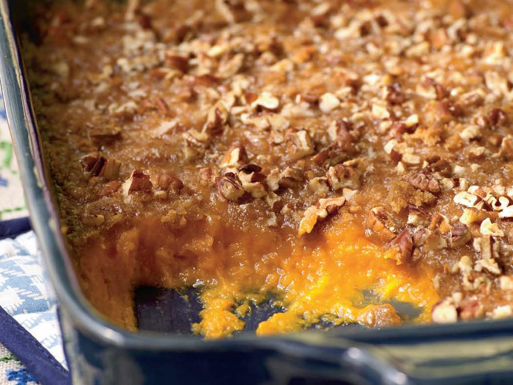 For this classic casserole, whip sweet potatoes until they're smooth and top with a delicious, buttery brown sugar and pecan mixture.