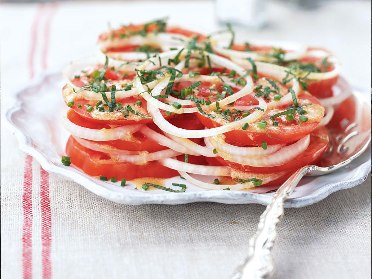 This simple no-cook salad is one of the best ways to highlight heirloom tomatoes, with its counterpoint of pungent raw onion and a light Dijon vinaigrette. You can also make this salad the spotlight of a great BLT (use the dressing in place of mayo), or add sliced mozzarella cheese for a Creole Caprese Salad.