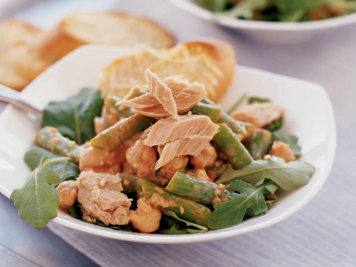 With fresh green beans, hearty garbanzos, and a smoky-creamy dressing, this Spanish tapas-style dish is unlike any other tuna salad you've tried. But it still takes less than 10 minutes to make and contains fewer than 400 calories per serving. High-quality tuna is a must; check European or Mediterranean markets for imported oil-packed tuna.