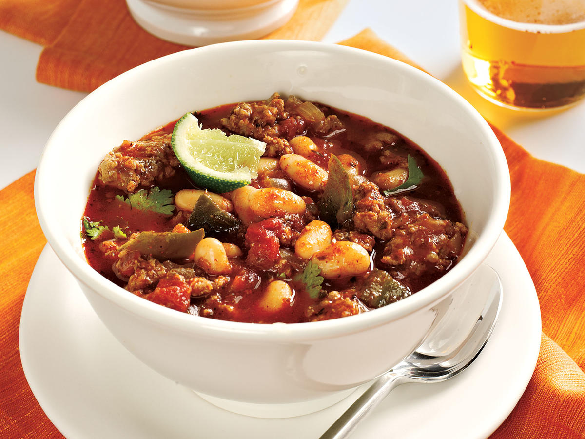 When you need a chili fix, and you need it fast, this recipe delivers. Twenty minutes are all you need for a piping hot pot of poultry, beans, and chili. We veer from the traditional beef and red bean formula and instead turn to ground turkey and white beans for a tasty variation. We call for ground turkey, not ultra-lean ground turkey breast, because the former stays more moist (you can also use ground sirloin if you prefer). One poblano pepper offers mild to medium heat, depending on the pepper; to ensure a mild version, sub in green bell pepper.