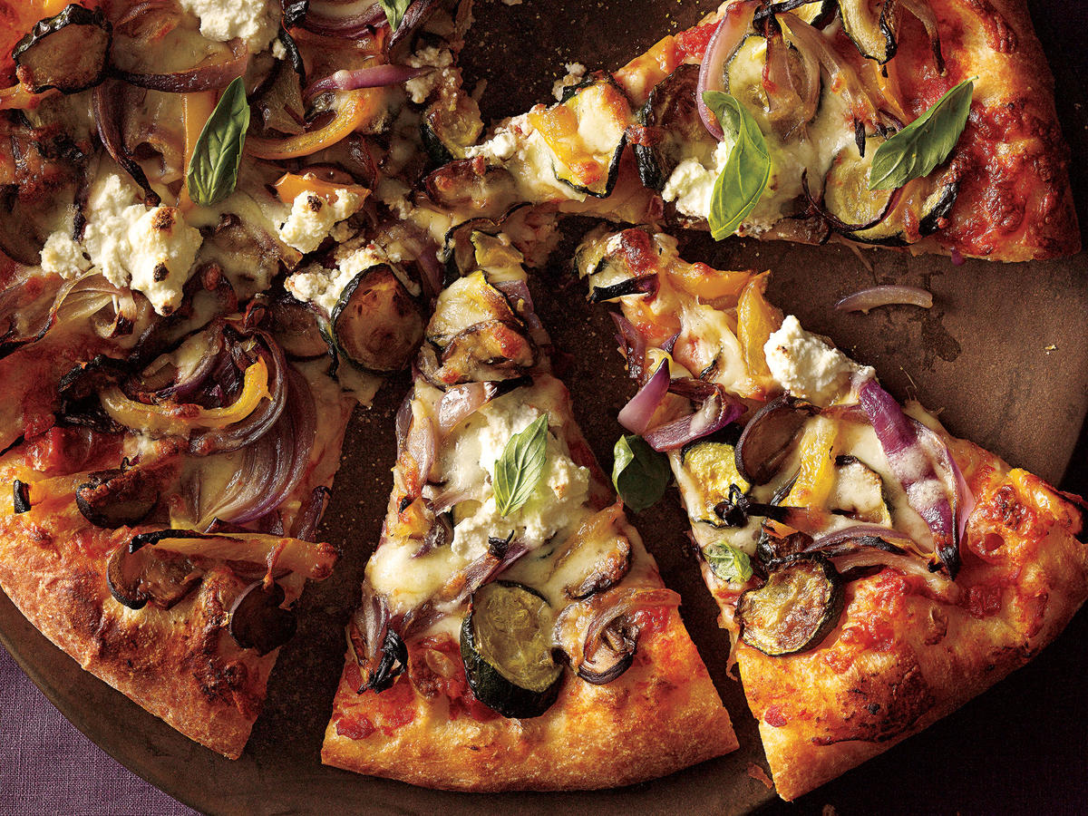 Slice-by-slice this yummy roasted vegetable pizza will disappear before your eyes. Ingredients like ricotta cheese, cremini mushrooms and fresh zucchini will keep you from ordering for delivery ever again.