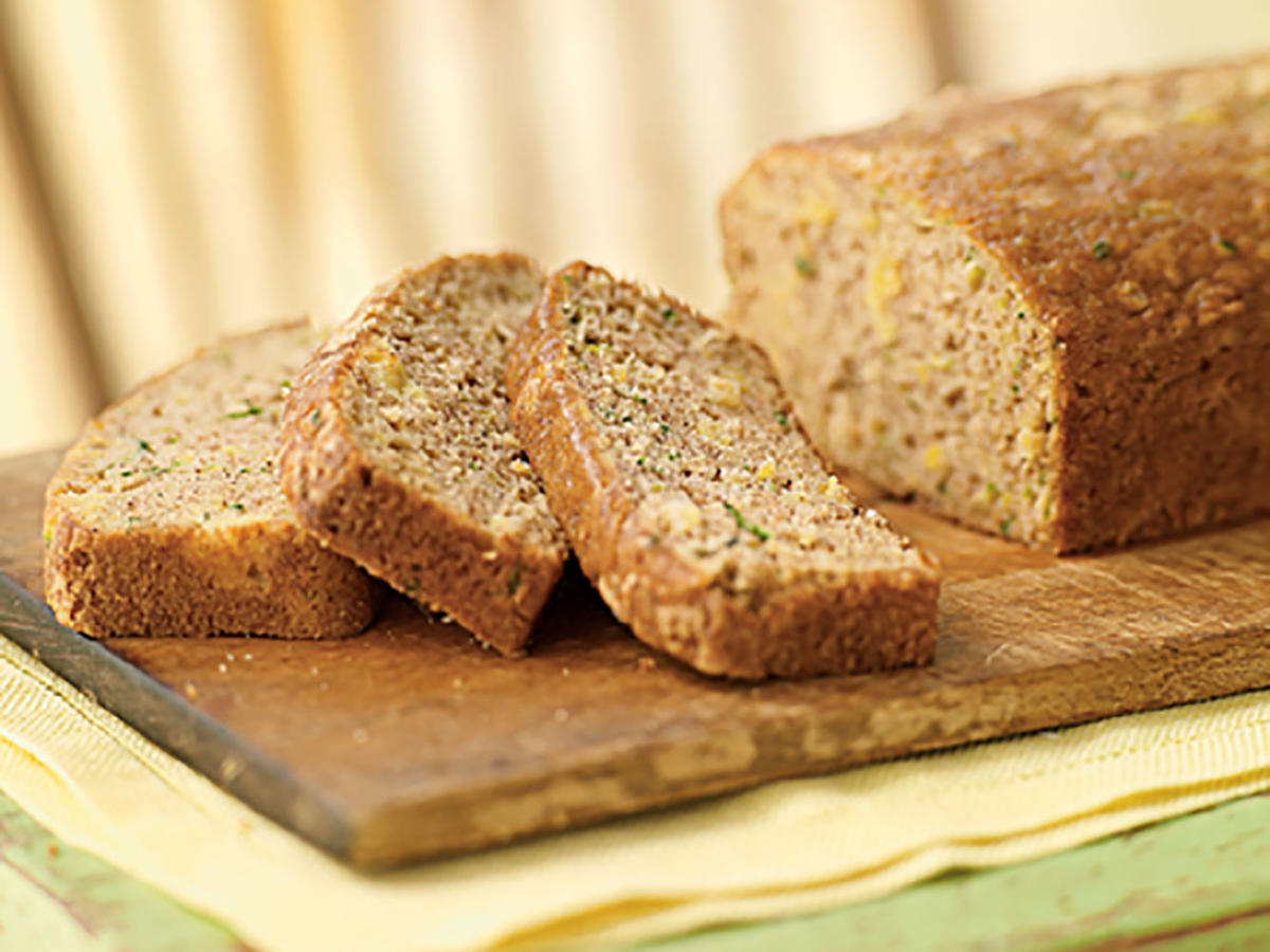 This zucchini quick bread has a tropical twist to it—crushed pineapple!  Cinnamon and vanilla tie the flavors together and make this a delicious treat for breakfast or a snack.
