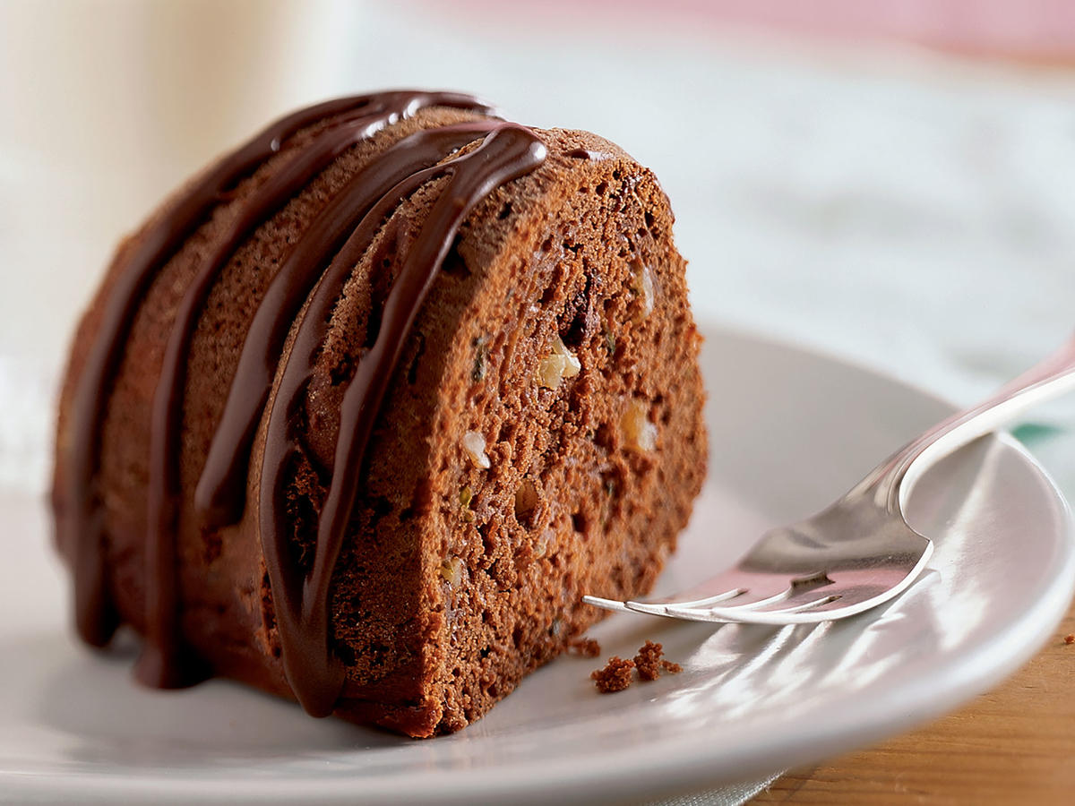 When you're testing the chocolate zucchini cake for doneness, insert the wooden pick in several different places. You may hit a melted chocolate, which might make you think the cake isn't done.