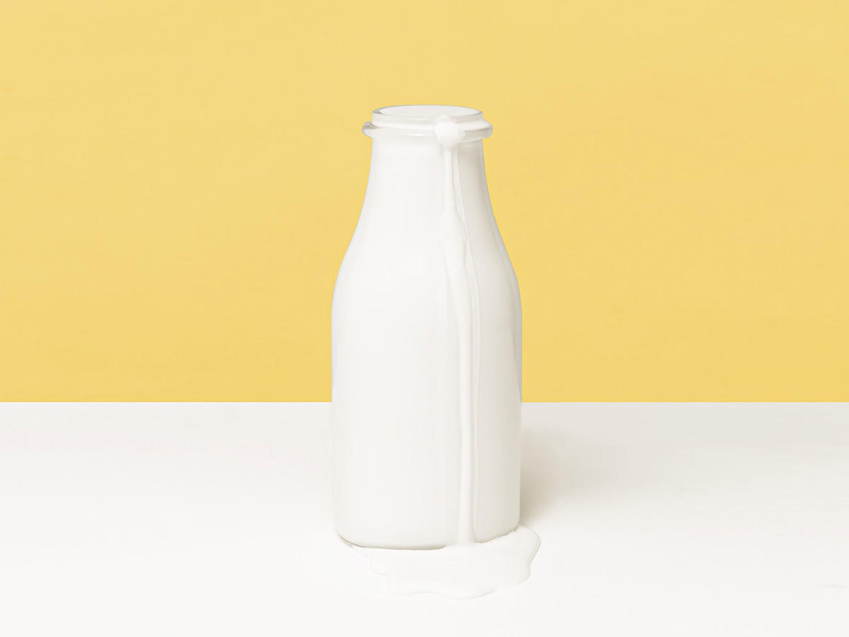 Close-Up Of Milk Bottle On Table