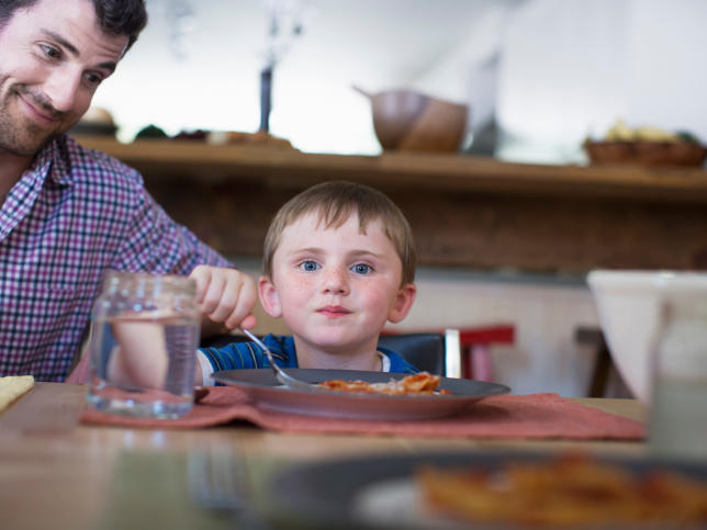 gettyimages-465892357-father-son-family-dinner.jpg